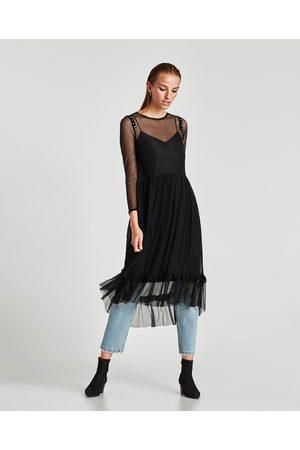Vestido negro volantes zara