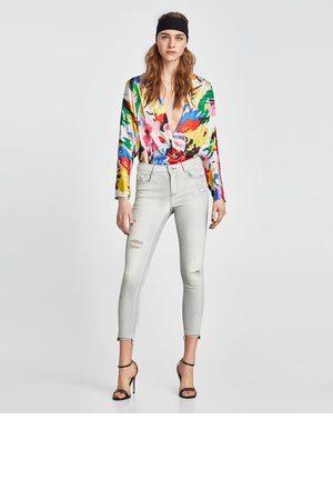 Zara JEANS SKINNY ROTOS - Disponible en más colores