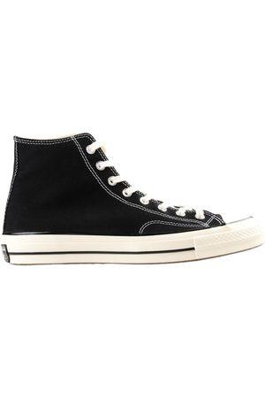 Converse Sneakers abotinadas