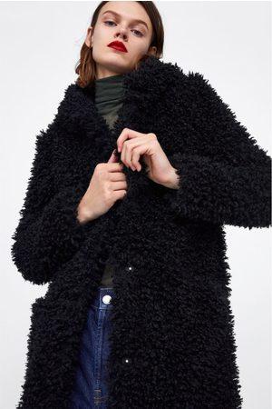 Zara abrigo efecto pelo hombre