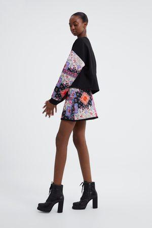 Zara Falda mini estampada acolchada