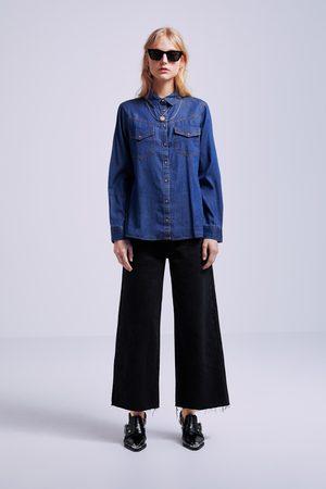 Zara Camisa denim bolsillos