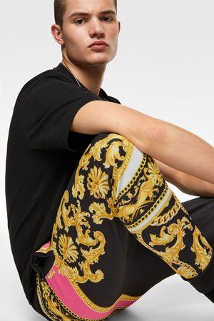 Zara Pantalón jogger estampación barroca flúor