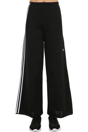 hot sale online 709ee 9b3c3 adidas Pantalones Deportivos De Techno Con Pierna Ancha