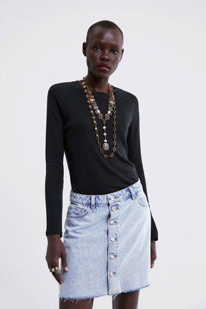 Zara Falda mini denim botones