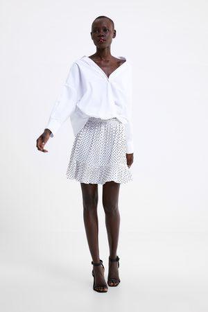 Zara Falda mini plisada