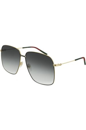 Gucci GG0394S 001 Shiny Endura Gold/Shiny Black