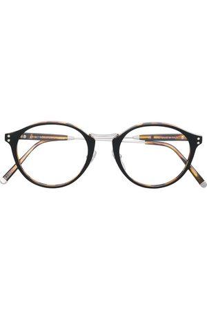 Retrosuperfuture Gafas redondas con efecto carey