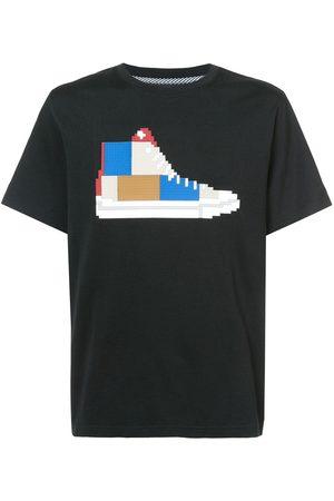 MOSTLY HEARD RARELY SEEN Camiseta con motivo de zapatilla estilo patchwork