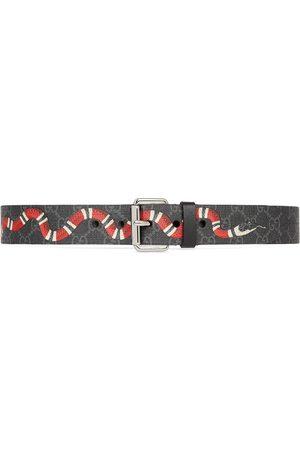 Gucci Cinturón GG con motivo de serpiente real