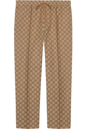 Gucci Pantalones joggers de lona