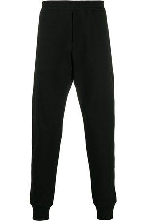 Alexander McQueen Pantalones de chándal con parche de calavera
