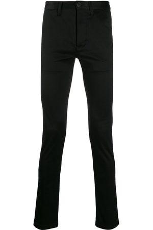 Saint Laurent Pantalones chinos ajustados