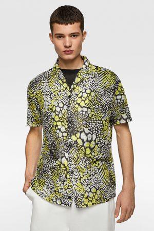 Zara Camisa punto estampado animal