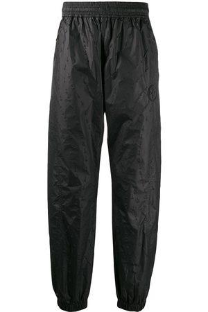 OFF-WHITE Pantalones de chándal texturizados
