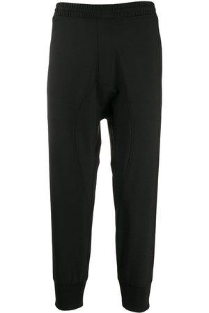 Neil Barrett Pantalones joggers con diseño de paneles