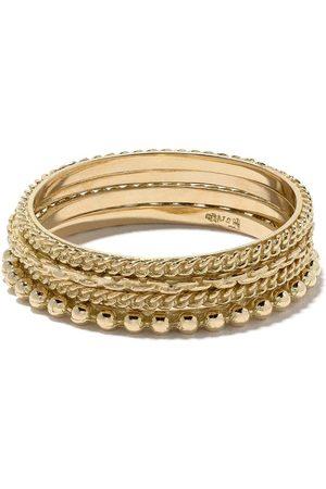 WOUTERS & HENDRIX Set de cuatro anillos en oro de 18kt