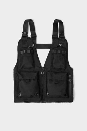 Zara Accesorio pecho multi-bolsillos cremallera