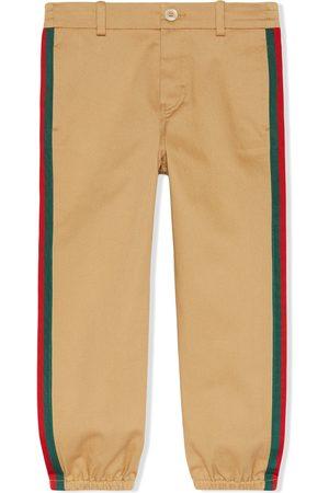 Gucci Pantalones con detalle de tribanda