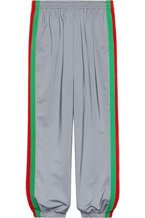 Gucci Pantalones de chándal con franjas reflectantes