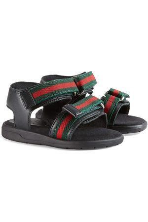 Gucci Sandalias de piel con correas de tribanda