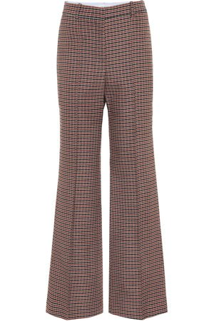 Victoria Beckham Pantalones flared de lana tiro alto
