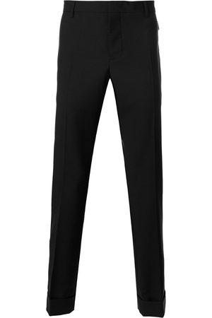 VALENTINO Pantalones con bolsillos con cremallera