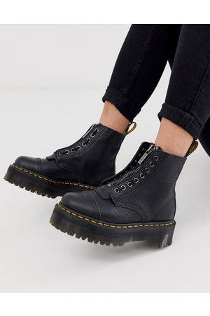 Dr. Martens Mujer Botas y botín - Botas de cuero con cremallera y plataforma plana en negro granulado Sinclair de