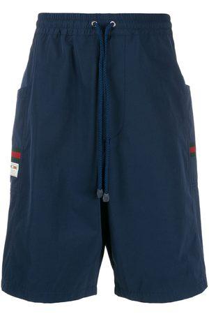 Gucci Pantalones cortos de deporte con parche del logo