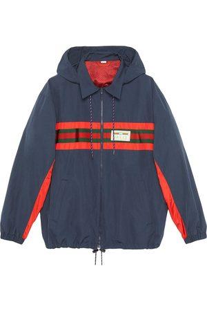 Gucci Cortavientos con capucha y parche del logo