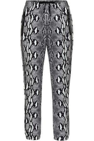 Adam Selman Sport Leggings con estampado de serpiente