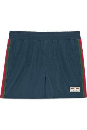 Gucci Hombre Shorts de baño - Short de baño impermeable con tribanda Web