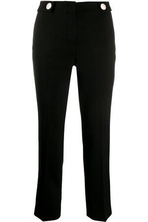 Prada Pantalones ajustados con detalle de botones