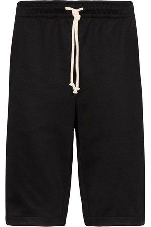 Gucci Pantalones cortos de deporte GG Web