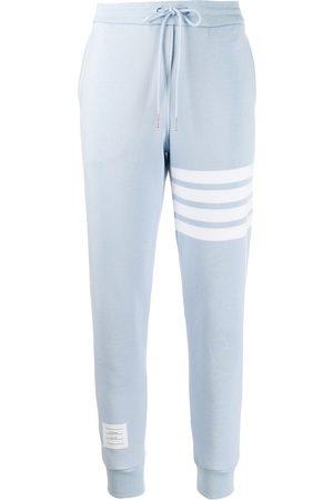 Thom Browne Pantalones de chándal con detalle de rayas