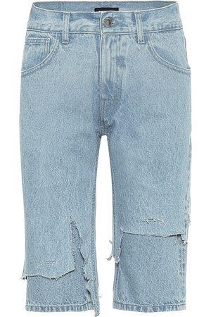 RAF SIMONS Shorts de jeans desgastados