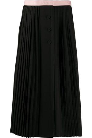 Gucci Falda plisada con logo en la cinturilla