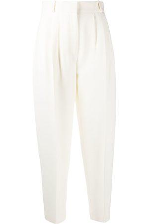 Alexander McQueen Pantalones tapered con pliegues