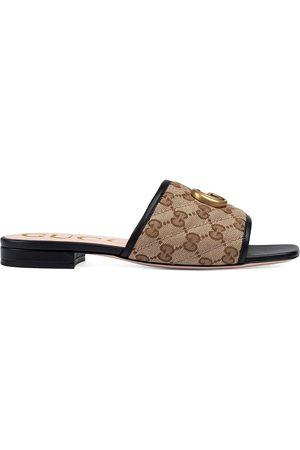 Gucci Mujer Zuecos - Mules con motivo GG