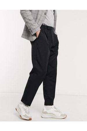 ASOS Hombre Pantalones chinos - Pantalones elegantes de corte tapered extragrandes en negro de