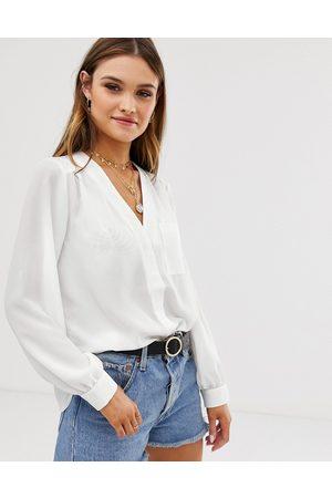 ASOS Mujer Manga larga - Blusa de manga larga con detalle de bolsillo en marfil de -Blanco