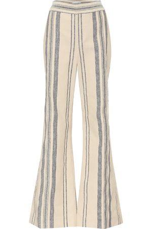 MONSE Pantalones flared de rayas
