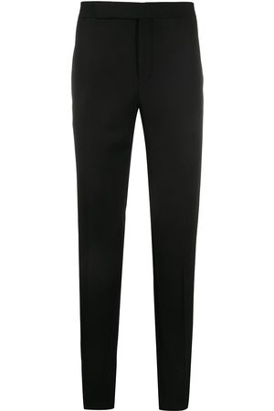 Saint Laurent Pantalones de vestir con rayas laterales