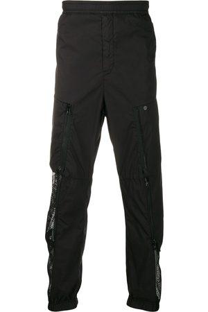 STONE ISLAND SHADOW PROJECT Pantalones de chándal con panel de malla