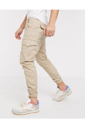 Jack & Jones Pantalones cargo de corte slim con bajos ajustados en color arena claro de Intelligence-Tostado