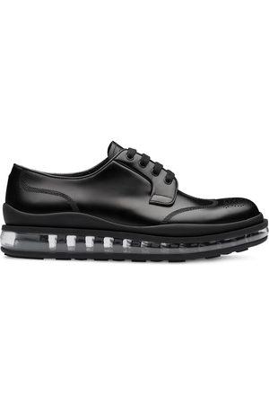 Prada Zapatos derby con detalles de mocasines