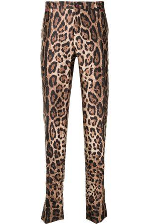 Dolce & Gabbana Pantalones slim con estampado de leopardo