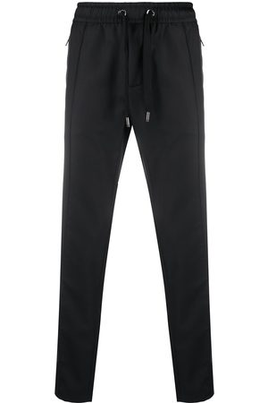 Dolce & Gabbana Pantalones con placa de logo