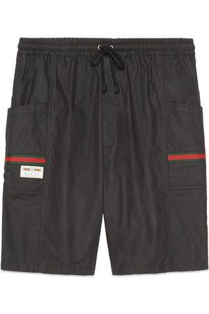 Gucci Hombre Pantalones cortos - Short de algodón revestido con etiqueta