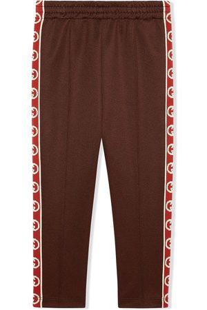 Gucci Pantalones de chándal con G entrelazada